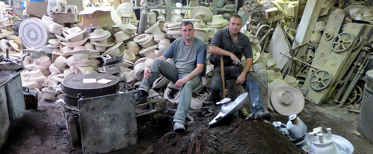 two men sat on hat blocks